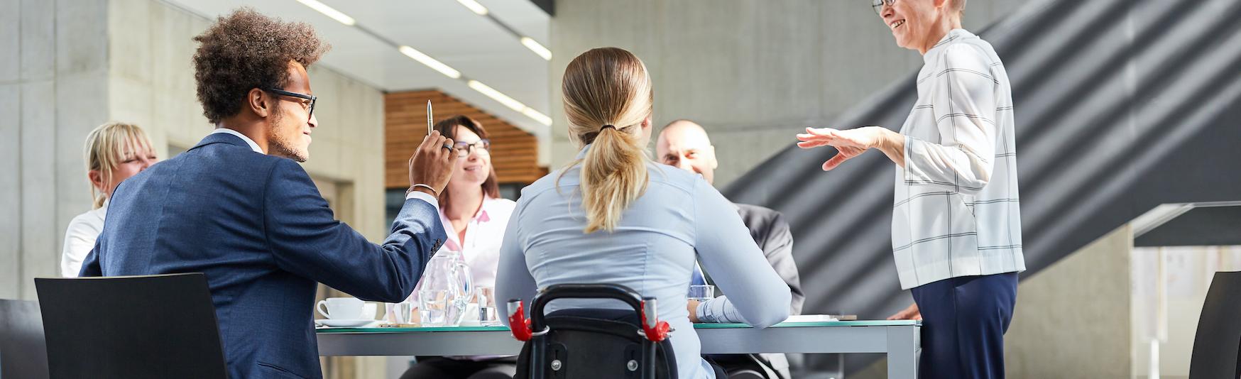 LP_Header-1748x534-dei-coworkers-wheelchair-diverse-meeting