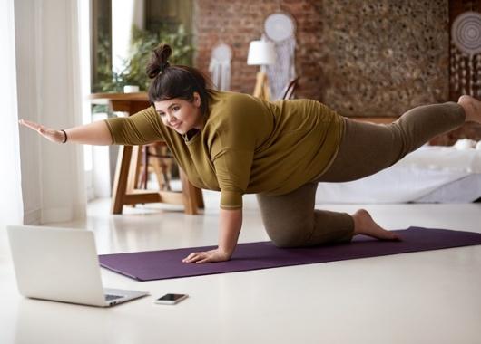 ES_Header-600x430-heavier-woman-yoga-exercise-wfh-active-physical-1