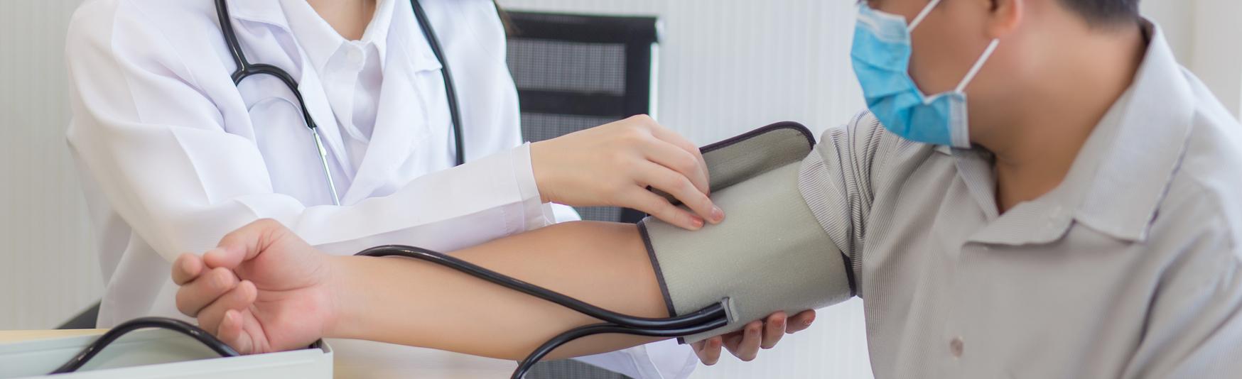 LP_Header-1748x534-asian-woman-doctor-blood-pressure-diabetes-asian-male-patient-masks