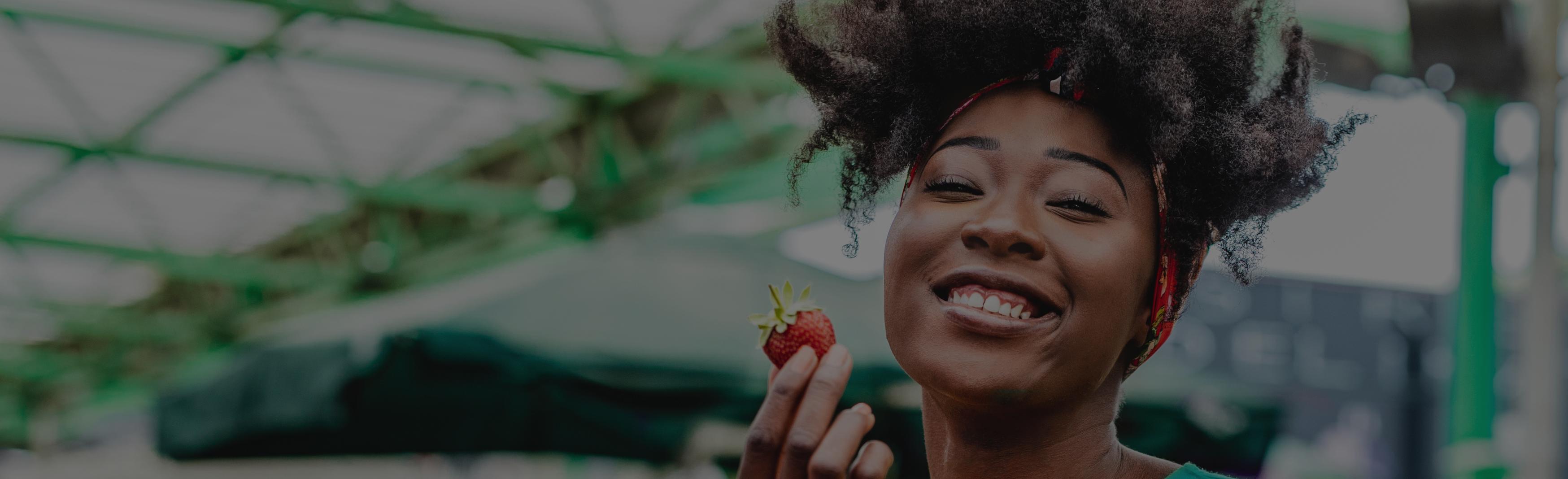 LP_Header-1748x534-grey-african-american-woman-eating-fruit-nutrition-healthy